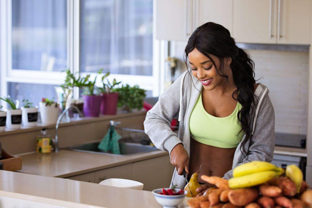 woman-cutting-fruit