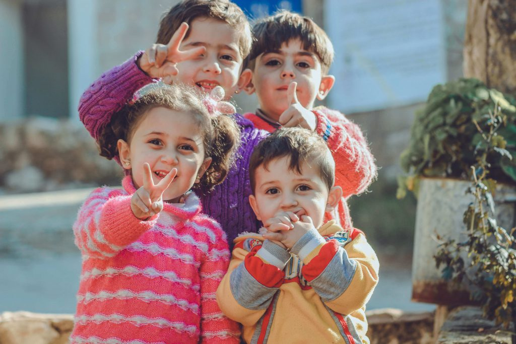 four-children-posing-for-camera