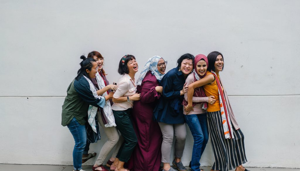 Group of women standing together and embracing