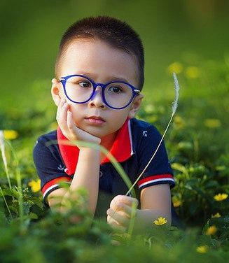 Boy in glasses for sight saving month
