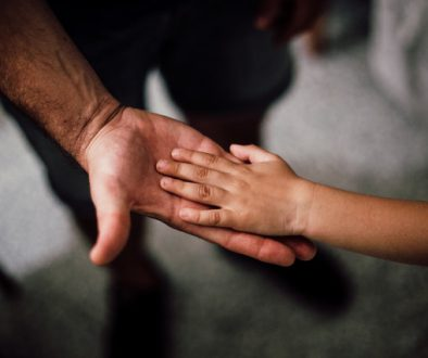 father and son hand holding